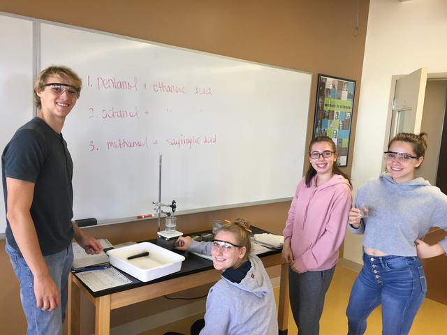 Students perform an experiment in a science lab