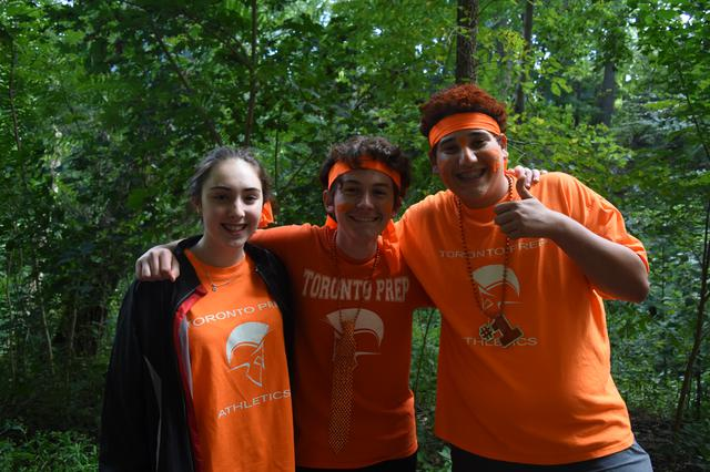 Students outdoors in their orange house colours
